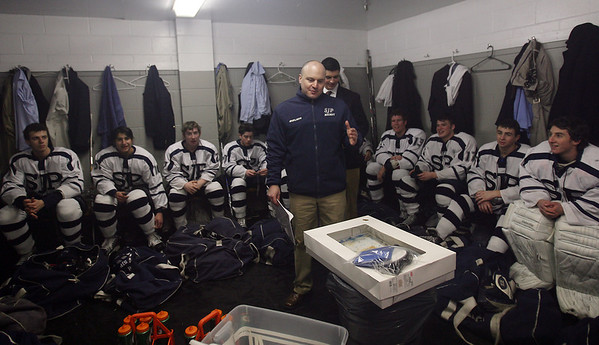 St. John's Prep head coach Kristian Hanson addresses his team after a big win over Austin Prep. David Le/Staff Photo