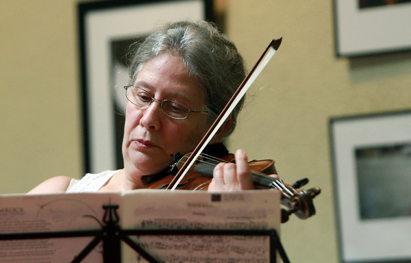Founder of Music at Eden's Edge, Maria Benotti, plays Ernst von Dohnanyi's Sonata in C Minor, Op. 21, on the violin at the Northshore Unitarian Universalist Church in Danvers on Tuesday. David Le/Staff Photo