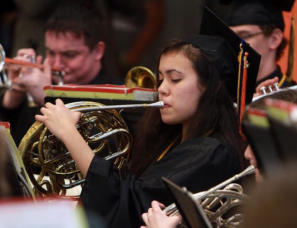 Beverly High School senior Anita Richardson plays with the BHS Band one last time during graduation on Sunday afternoon. David Le/Staff Photo