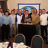 The Danvers High School Basketball Team poses for a photo with Rob Prentiss, President of the Touchdown Club of Danvers, center left, Vice-President Mike Hagan, center right, and State Representative Ted Speliotis of Danvers, left. David Le/Staff Photo