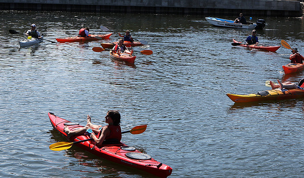 Salem: A small group of kayakers decided to stay cool and attend the opening ceremonies for the Harborwalk in style as they sat in the South River in downtown Salem on Thursday afternoon listening to the speeches and performances. The Harborwalk runs along the South River basin from Congress Street to Layfayette Street. Photo by David Le/Salem News