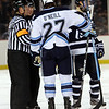 UMaine captain and Salem native Will O'Neill talks with the referees about a penalty against UNH on Saturday night. David Le/Salem News