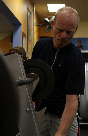 Ipswich: Pete Buletza of Ipswich adjusts the weight on the bench press at the Ipswich Family YMCA on Wednesday afternoon. Photo by David Le/Salem News