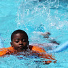 Salem: Samiir Desir, 7, of Salem kicks and paddles his way across the Forest River Park pool with the help of a noodle during a free swimming lesson on Thursday afternoon. The Forest River Park pool offers free swimming lessons to all Salem residents. Photo by David Le/Salem News