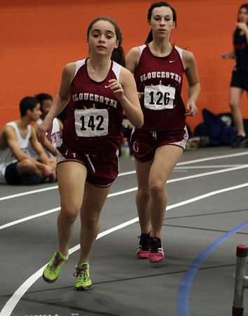 Gloucester's Michelle Quinn (142) and Cecily Francis (126) compete in the mile against Revere on Wednesday.  David Le/Salem News