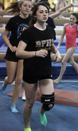 Yellowjackets gymnast Taylor Shelgren runs as a warmup before practice. David Le/Staff Photo.