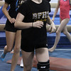 Yellowjackets gymnast Taylor Shelgren runs as a warmup before practice. David Le/Staff Photo.