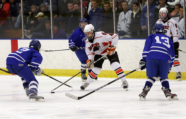 Salem: Beverly's Ted Leathersich (4) center, takes a shot on goal between a crowd of Danvers defenders. David Le/Salem News