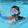 Salem: Joey White, 7, of Salem surfaces for air during a free swimming lesson at the Forest River Park swimming pool on Thursday afternoon. The Forest River Park pool offers free swimming lessons to all Salem residents. Photo by David Le/Salem News