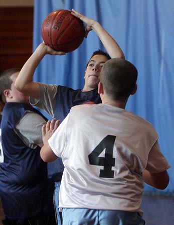 Nick Merriman (left) hits a jump shot during a PBA basketball game on Saturday morning. David Le/Salem News