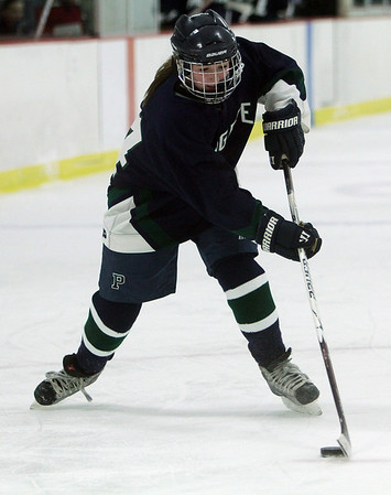 Pingree's Leah Heinze controls the puck in the offensive zone on Friday vs. Portsmouth Abbey. David Le/Salem News