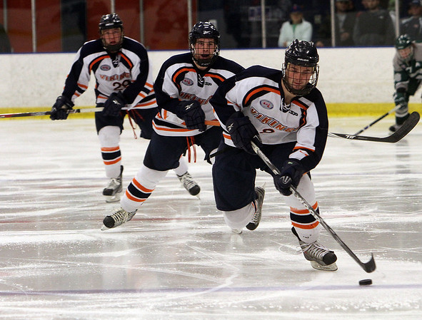 Salem State player Brian Hanafin (8) right, leads a charge up ice followed closely by two teammates on Thursday night. David Le/Salem News