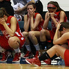 From left, Masco seniors Brooke Stewart, Chelsea Nason, junior Claudia Marsh, and senior Taylor Evans, are overcome with emotion following a loss in the D1 North Title game to Andover, ending their 2012 playoff run. David Le/Staff Photo
