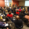 A roomful of people at the Enterprise Center at Salem State University listen as School Superintendent Steve Russell, right, and Mayor Kim Driscoll address issues on how to quickly improve Salem schools. David Le/Salem News