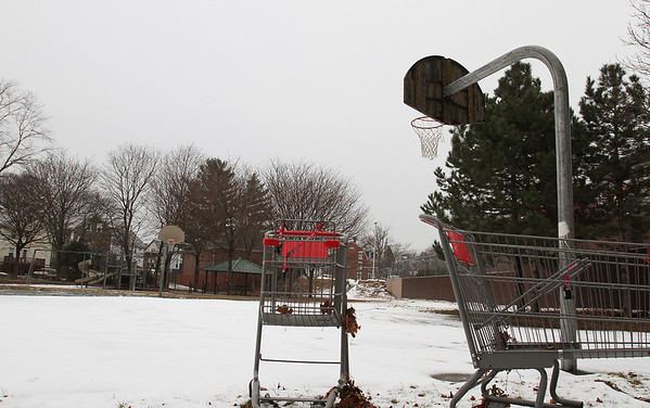 A few abandoned shopping carts stood near the snow-covered basketball courts at Splaine Park on Essex St. in Salem. David Le/Salem News