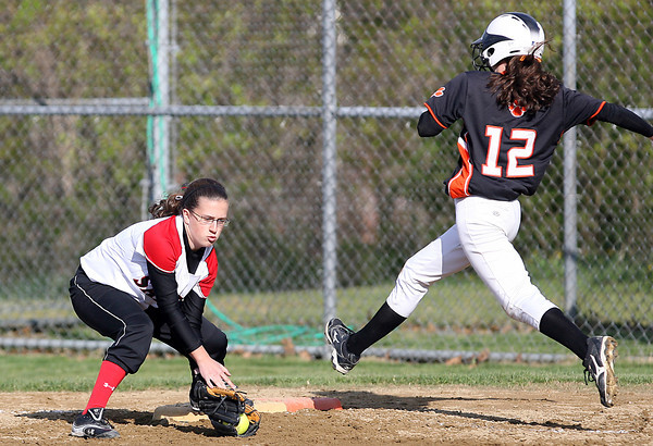 Salem first baseman Mikayla Dion, left, digs out a ball in the dirt to beat leaping Beverly baserunner Ally Pia, right, on Tuesday afternoon. David Le/Staff Photo
