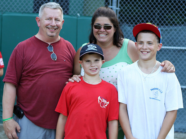 Beverly: From left, Kevin, Trevor, 9, Lisa, and Hunter Josselyn, 12, pose for a picture after Trevor received the J.J. Nicastro award before the District 15 Little League Championship game on Friday evening. Photo by David Le/Salem News