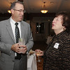 Jim Muse, of North Shore Bank, and Patricia Zaido, Executive Director of the Salem Partnership chat at the annual Holiday Party at Finz Restaurant on Tuesday evening. David Le/Salem News