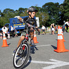 Ryan Lovasco, 7, of Beverly, rides his bike around some cones during a bike safety event put on by the Beverly Police and Fire Departments. David Le/Staff Photo