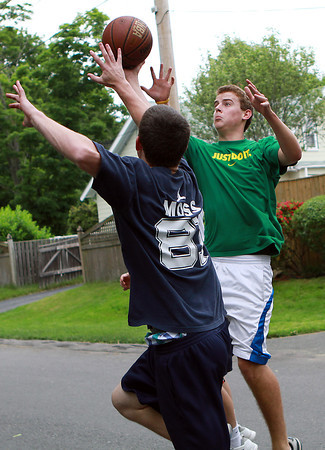 Mike Doane, 19, right, of Beverly, plays pickup street basketball with his friend Austin Butler, 20, left, also of Beverly on Tuesday afternoon. David Le/Staff Photo