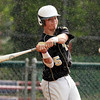 Bishop Fenwick third baseman Nick Bona makes solid contact off Lynnfield through a steady drizzle on Thursday afternoon. David Le/Staff Photo