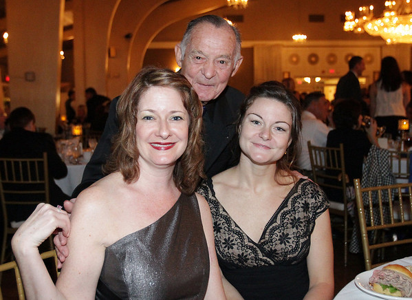 Allyson Hines, left, of Biba Hair Salon, Beverly artist Nino Lombardi, and Stephanie Doiron at Mayor Bill Scanlon's Inaugural Ball on Friday evening at Danversport Yacht Club. David Le/Salem News.