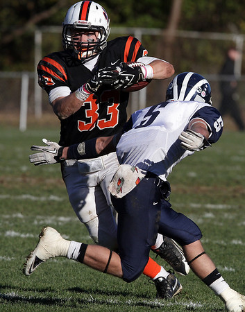 Beverly running back Brendan Flaherty (33) cuts back, and surges forward for positive yardage against Swampscott on Saturday afternoon. David Le/Salem News