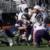 Hamilton-Wenham's Ryan Foringer (52) drags down Bourne quarterback Jason Moriarty. David Le/Salem News