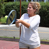 Mary Brennan, 20, of Beverly, concentrates on returning a volley while playing tennis with her cousins at Kimball-Haskell Park on Wednesday afternoon. David Le/Staff Photo