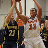 Salem State foward Kristen Federico (33) right, battles for the ball with USM's Jordan Grant (33) left, on Tuesday evening. David Le/Salem News