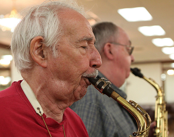 Salem: Paul Vignoli, left of East Boston, and Bob Lynn of Saugus, practice with the North Shore Concert Band for a free concert series starting June 29th at the Salem Willows. Photo by David Le/Salem News