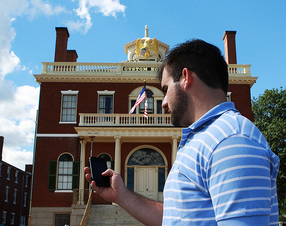 Salem: Joe Kostka, of Lynn, tries out a new free application for the City of Salem on the iPhone. This new app allows users to browse attractions, museums, city tours, restaurants, lets you book trolley tickets and more. Photo by David Le/Salem News