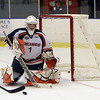 Salem State goalie Ryan Sutliffe (1) watchesthe puck closely as it flies by the net. David Le/Salem News