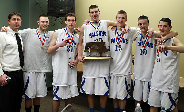 From left, Danvers Head Coach John Walsh, junior Nick McKenna, junior Dan Connors, senior George Merry, junior Nick Bates, senior Jon Amico, and junior Eric Martin, holding the Championship Trophy in the Media Room at the DCU Center in Worcester.  David Le/Staff Photo