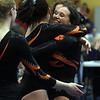 Beverly's Taylor Metta, right, gets mobbed by her teammates after her balance beam routine on Friday night. David Le/Salem News