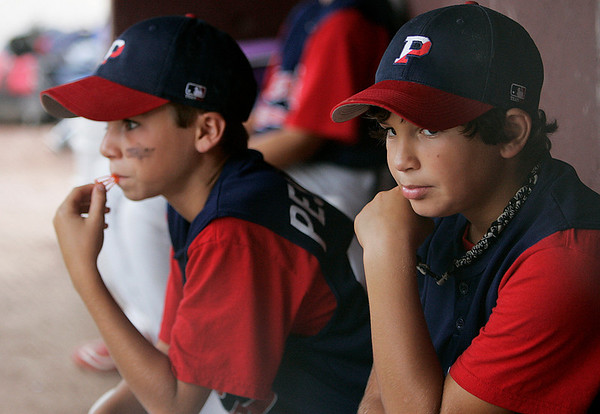 Danvers: Gabe Pesatoro, left, and Sean Nysocki, of the Peabody West eleven year-old All-Star team hold their breath in the final innings of the Jimmy Fund Championship game against Danvers American at Tapley Field in Danvers on Saturday afternoon. Danvers American barely edged out Peabody West 8-7 to take the championship home in a slugfest that featured 4 monster homeruns by both sides. Photo by David Le/Salem News