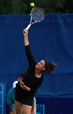 Former World No. 1 tennis player and three time Grand Slam winner Lindsay Davenport, smashes a serve against the Boston Lobsters while playing with the Orange County Breakers on Tuesday evening at the Ferncroft Country Club. David Le/Staff Photo