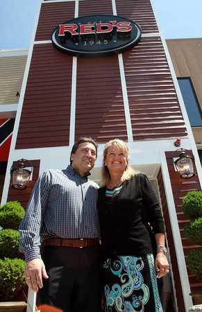 John and Lisa Drivas, owners of Red's Kitchen and Tavern, stand outside their brand new restaurant which opened two weeks ago. The couple also own Red's Sandwich Shop in downtown Salem, and have expanded to open this new restaurant located at 131 Newbury St. in Peabody, off of Route 1 North. David Le/Staff Photo