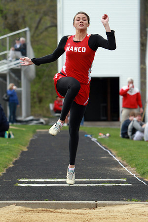Masconomet senior Chelsea Nason launches off one foot during the long jump against Hamilton-Wenham on Wednesday afternoon. David Le/Staff Photo