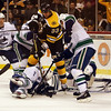 Bruins captain Zdeno Chara battles in front of the net with multiple Vancouver players in the final seconds of Saturday's game. David Le/Salem News