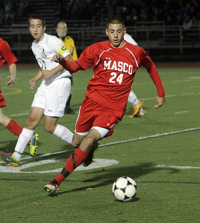 Masco senior Joe Dussi controls the ball against Greater New Bedford in semi-final action on Tuesday. David Le/Salem News