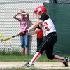 Marblehead senior shortstop Kathryn DiGiammarino lines a sharp base hit against Malden on Monday afternoon. David Le/Staff Photo