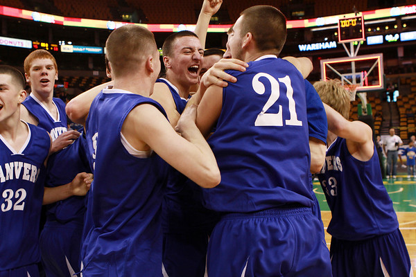 The Danvers High School boys basketball team celebrates a 68-45 victory over Wareham on Monday afternoon at the TD Garden. With the win the Falcons advance to the D3 State Final at the DCU Center in Worcester on Saturday. David Le/Staff Photo