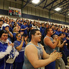 Danvers High School fans get pumped up before overtime on Tuesday night at Lawrence High School. David Le/Staff Photo