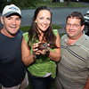 Zeke the turtle, center, was found by Tom Fortunato, right, after being away from the home of Bob and Debbie Young, left, for 30 days until he was located. David Le/Staff Photo