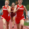Masco's Mackenzie Shelgren, right, cruises to the finish line to win the 800, followed closely by teammate Emily Wheeler, left, on Wednesday afternoon. David Le/Staff Photo