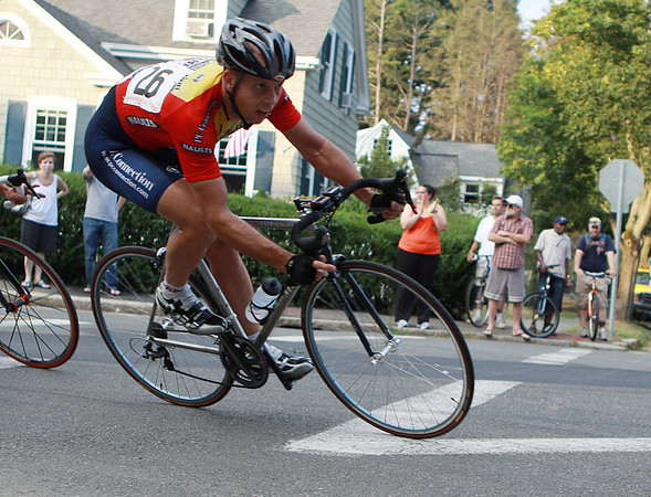 Beverly: One of the riders in the Men's Pro Division of the Beverly Grand Prix takes a sharp turn during the second lap of the race which started at 6:30 on Wednesday evening and ran through the downtown area of Beverly. Photo by David Le/Salem News