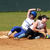 Danvers Junior captain Julia Saggese slides safely into second after stealing the base against Dracut on Sunday afternoon. David Le/Staff Photo