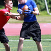 Peabody High School receiver Matt Ward, right, hauls in a touchdown while being pressured by a Middlesex defender during a 7 on 7 Tournament at Bishop Fenwick High School on Saturday. David Le/Staff Photo