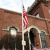 Peabody: With the flag at half-mast, a memorial for fallen Peabody firefighter Jim Rice was assembled outside the Peabody Fire Station. David Le/Salem News